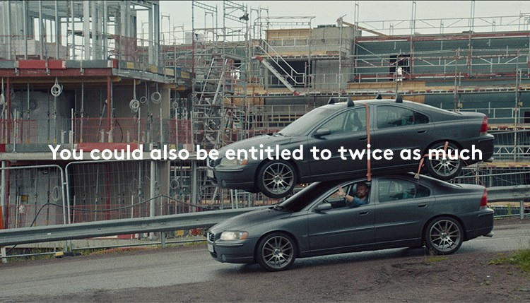 The images shows a man driving a car with an extra car on the roof. The caption on the image reads You could also be entitled to twice as much.